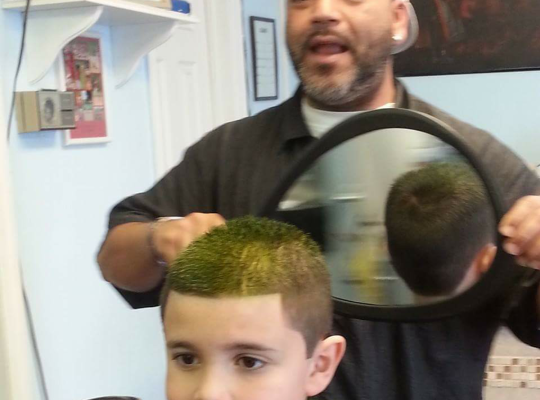How this barber helped a little boy with autism learn to love haircuts